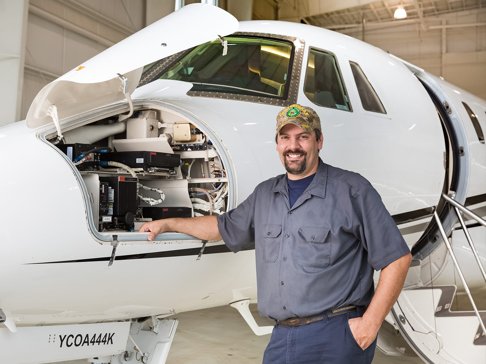 A smiling Priority Jet maintenance technician
