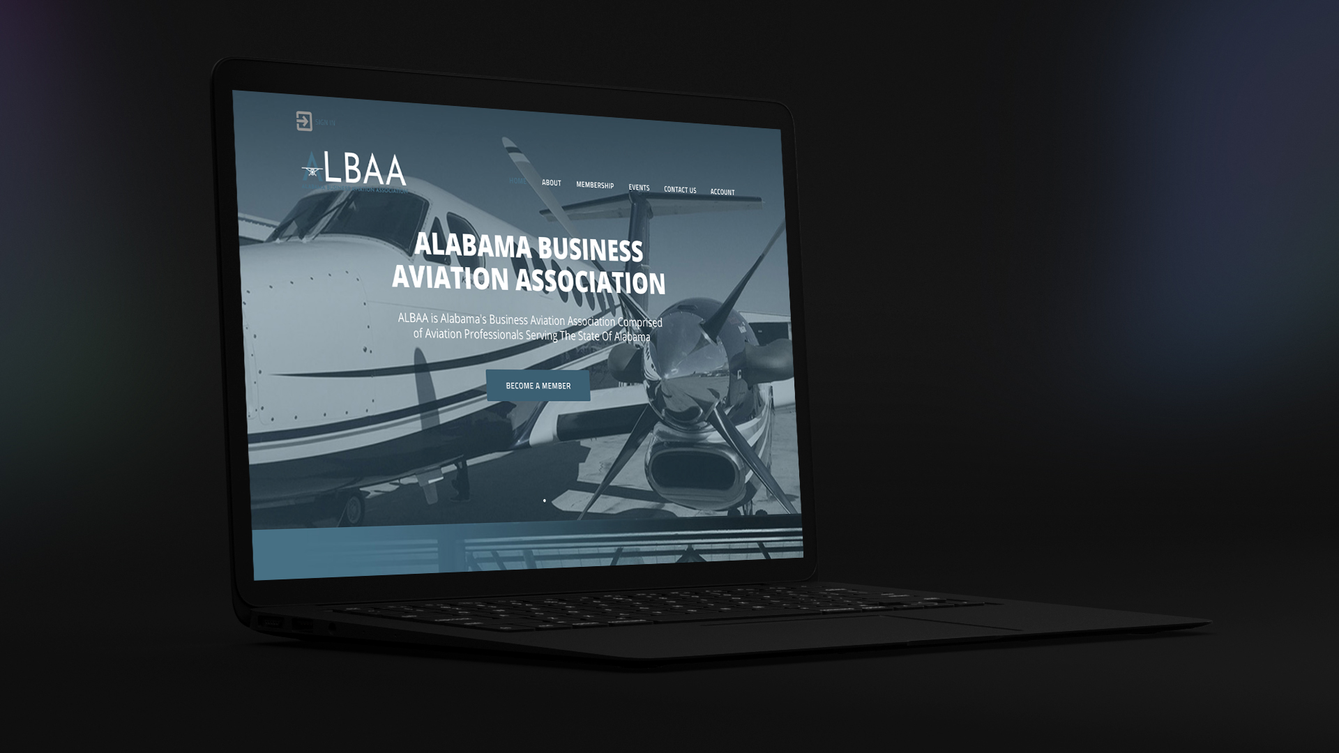 a picture of an Adam Black Media website on a laptop