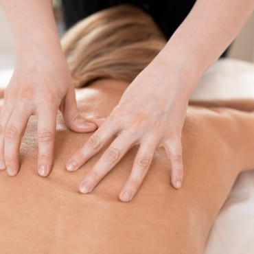 A woman receiving massage therapy