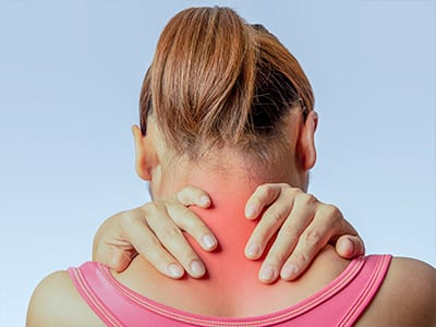 A woman suffering from servical back/neck pain