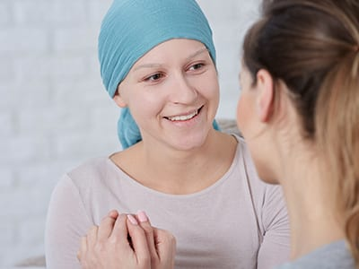 A smiling woman suffering from cancer